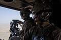 U.S. Marine Corps Gunnery Sgt. Robert Riley, left, a maintenance control staff noncommissioned officer, and Cpl. Juan Alcaraz, a crew chief, both with Marine Light Attack Helicopter Squadron (HMLA) 167, ride 130523-M-RF397-032.jpg