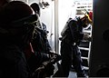 U.S. Navy Chief Petty Officer Anthony Bunting, center, monitors repair locker firefighters during an engineering casualty drill aboard the guided missile frigate USS Simpson (FFG 56) March 16, 2012, while under 120316-N-ON468-026.jpg