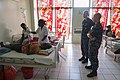 U.S. Navy Hospital Corpsman 2nd Class Bradford Vogel, right, and Lt. Cmdr. Heather Hellwig, second from right, a pharmacist, watch as a nurse gives a patient medication during Pacific Partnership 2013 in Gizo 130802-N-SP369-253.jpg