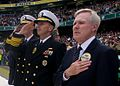 U.S. Secretary of the Navy Ray Mabus, right, and U.S. Navy Chief of Naval Operations Adm. Jonathan Greenert, center, render honors as the national anthem is played during the Emerald Isle Classic college 120901-N-AC887-002.jpg