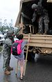 U.S. Soldiers with the 1st Battalion, 155th Infantry Regiment, Mississippi Army National Guard evacuate a resident from an area flooded from Hurricane Isaac in Mississippi Aug. 29, 2012 120829-Z-MX357-002.jpg
