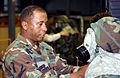 US Air Force (USAF) Lieutenant Colonel (COL) Alexander, Deputy Commander of Operations (DCO), inspects a troops MCU-2A-P mask during the chemical warfare training Exercise SABERTOOTH 2002 021016-F-JF472-354.jpg