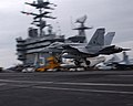 US Navy 021025-N-4953E-001 An F-A 18 'Hornet' assigned to the 'Gunslingers' of Strike Fighter Squadron One Zero Five (VFA-105), performs a 'touch and go' on the ship's flight deck.jpg