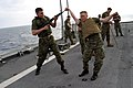 US Navy 040220-M-4806Y-024 Lance Cpl. Hunter Foskey, left, and 2nd Lt. Brian Donlon, both assigned to 2-6 Echo Company II Marine Expeditionary Force (MEF) demonstrate martial art techniques for Marines.jpg