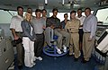US Navy 040303-N-5319A-011 Professional golfer Tiger Woods poses in the admiral's chair.jpg