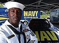 US Navy 040501-N-5362A-075 Naval Counselor 1st Class Irving McNeil, a Navy Recruiter assigned to the Naval Recruit Depot, San Diego, stands in front of the Navy sponsored NASCAR.jpg