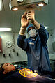 US Navy 040625-N-0684R-025 Dental Technician 3rd Class Christopher Williams, from Houston, Texas, adjusts a surgical light during preparations for oral surgery aboard the Nimitz-class aircraft carrier USS John C. Stennis (CVN 7.jpg