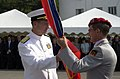 US Navy 041008-N-8861F-006 Commander Naval Forces Europe, Adm. Michael Mullen, passes the command colors to Command Sergeant Major Heiko Schulze.jpg
