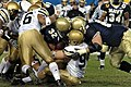 US Navy 041204-N-2383B-227 Navy Kyle Eckel fights for a first down, during the 105th Army Navy game.jpg