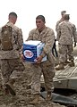US Navy 050111-N-4383M-138 Lance Cpl. Benitez, assigned to 15th Marine Expeditionary Unit (MEU), assists with the unloading of needed food, water and relief supplies.jpg