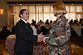 US Navy 050325-N-2385R-034 Master-at-Arms 1st Class Catherine Chavarria, right, awards a Navy Exchange gift certificate as a door prize to Master-at-Arms 2nd Class Tiffany Howard.jpg