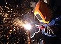 US Navy 051114-N-7748K-018 Hull Technician 3rd Class Jesse Delong of Bridgewater, Maine, practices cutting metal using a Carbon arc aboard the nuclear-powered aircraft carrier USS Enterprise (CVN 65).jpg