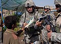 US Navy 060325-N-6901L-048 U.S. Army soldiers hand out maps and information to the residents of Tarmiya, about safe routes they have to take entering or leaving their town because of ongoing counter-insurgency operations in the.jpg