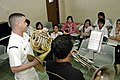 US Navy 070209-N-2746N-111 Musician 2nd Class Robert Booker, assigned to the 7th Fleet Band, instructs Karlo Espirito of the University of Santo Tomas Conservatory of Music.jpg
