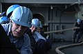 US Navy 070322-N-7130B-311 Deck seamen, assigned to deck department aboard Nimitz-class aircraft carrier USS Ronald Reagan (CVN 76), heave around the a mooring line on the ship's fantail.jpg