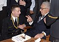 US Navy 070411-N-5390M-002 Former National Security Advisor and Secretary of State Dr. Henry A. Kissinger talks with Midshipman 3rd Class Roger Misso after an address to the Brigade of Midshipmen at the U.S. Naval Academy.jpg