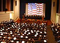 US Navy 070430-N-6247M-002 A memorial service is held in the base theater on Naval Air Station Whidbey Island in honor of three Explosive Ordnance Disposal Unit members that lost their lives in Iraq, April 6, 2007.jpg