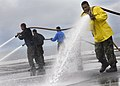 US Navy 070627-N-4166B-114 Sailors spray the flight deck of Nimitz-class aircraft carrier USS Abraham Lincoln (CVN 72) during an aqueous film forming foam (AFFF) countermeasure wash down.jpg