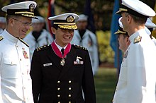 US Navy 070724-N-6512M-035 Chief of Naval Operations (CNO) Adm. Mike Mullen and Chief of Republic of Singapore Navy Rear Adm. Ronnie Tay enjoy a light moment while talking with OPNAV staff.jpg