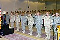 US Navy 080105-M-0000T-001 Members of the official party render a salute in front of a fallen comrade display during a memorial service held in honor of Petty Officer 1st Class Victor Jeffries.jpg