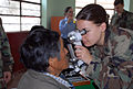 US Navy 080615-N-6410J-024 Lt. Megan Rieman, embarked aboard the amphibious assault ship USS Boxer (LHD 4), examines a patient's eyes at the Guillermo Enrique Billinghurst School in Barranca.jpg