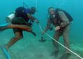 US Navy 080710-N-8968M-153 Constable Vincent Gregoire, a Regional Security Service diver from the Common Wealth of Dominica, conducts searching techniques.jpg