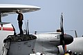 US Navy 080828-N-3659B-044 Airman Christopher Burns performs pre-flight checks on an E-2C Hawkeye on the flight deck of the Nimitz-class aircraft carrier USS Ronald Reagan (CVN 76).jpg