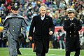 US Navy 081206-N-5549O-002 U.S. President George W. Bush is escorted onto the field by a U.S. Military Academy cadet and a U.S. Naval Academy midshipman.jpg