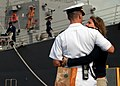 US Navy 090120-N-3666S-053 Lt. Cmdr. Matthew Fahner, assigned to the guided-missile destroyer USS Chung-Hoon (DDG 93), embraces his wife before the ship departs Naval Station Pearl Harbor.jpg