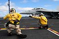 US Navy 090225-N-3946H-054 Lt. Cmdr. Noah Bellringer and Lt. Lee Zaltsman give the launch signal to an F-A-18F Super Hornet.jpg