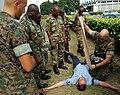 US Navy 090324-N-1655H-122 Marine Staff Sgt. Jason Elsdon demonstrates procedures for treating battle wounds to Nigerian infantrymen during an Africa Partnership Station combat lifesaving course.jpg
