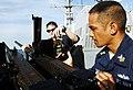 US Navy 090424-N-9928E-067 Gunner's Mate 1st Class Eddieesther Trinidad, left, from San Diego, Calif., helps Gunner's Mate 3rd Class Casey Gil, from Newaygo, Mich., load a .50-caliber machine gun.jpg