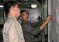 US Navy 090818-N-7058E-038 Republic of the Philippines Navy Lt. Mickey Simeon shows Lt. Mark Christopher the course of a vessel participating in a field training exercise during Southeast Asia Cooperation Against Terrorism.jpg
