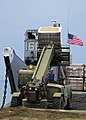 US Navy 100126-N-5244H-010 Seabees off-load pallets of humanitarian aid from Landing Craft Unit (LCU) 1664.jpg