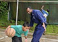 US Navy 100727-N-1675O-468 Religious Programs Specialist 1st Class Dana Saunders plays basketball with a Palauan child during a community service project at Melekeok Elementary School.jpg