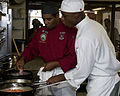 US Navy 100813-N-2389S-042 Culinary Specialist 2nd Class Juan Carethers work with a Le Cordon Bleu student during the Le Cordon Bleu cooking competition as part of Chicago Navy Week.jpg