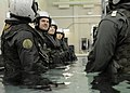US Navy 101013-N-5787K-051 Students at Aviation Survival Training Center prepare to submerge themselves in full gear to simulate worst-case scenar.jpg