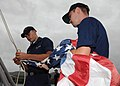 US Navy 101117-N-6165A-021 Personnel Specialist Seaman Benjamin Hollon and Hull Maintenance Technician Fireman Antonty Marino shift colors after ge.jpg