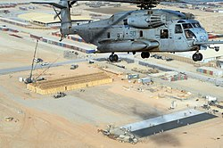 US Navy 110105-N-0318S-093 A U.S. Marine Corps CH-53 Sea Stallion helicopter flies over a Seabee project site in Camp Leatherneck, Afghanistan.jpg