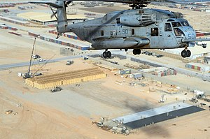 Camp Leatherneck - A U.S. Marine Corps CH-53 Sea Stallion helicopter flies over a Seabee project site in January 2011