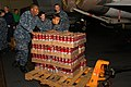 US Navy 110314-N-RG360-048 Sailors aboard the aircraft carrier USS Ronald Reagan (CVN 76) move cases of sports drinks and water in preparation to s.jpg
