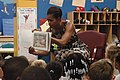 US Navy 110721-N-GZ984-120 First lady Michelle Obama reads to 5 and 6-year-olds at the Naval Air Station Oceana Child and Youth Programs summer cam.jpg