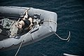 US Navy 110812-N-PB383-004 A Sailor assigned to the USS New Orleans (LPD 18) heaves a line on a rigid-hull inflatable boat before a practice missio.jpg