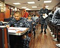 US Navy 110908-N-PQ745-006 Culinary Specialist 3rd Class Branigan Carles, left, takes the Navy-wide E-5 advancement exam in Carlson's Cafe.jpg