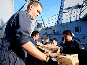 US Navy 111221-N-ZF681-456 Sailors aboard the guided-missile destroyer USS Halsey (DDG 97) unload supplies during a replenishment at sea with the M.jpg