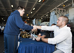 US Navy 120131-N-FI736-077 Jacksonville Jaguars players and cheerleaders sign autographs for Sailors and Marines in the hangar bay of the aircraft.jpg