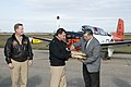 US Navy 120206-N-LY958-164 Navy representatives presents Dr. Mark Escamilla, president of Del Mar College, with maintenance logs for two T-34 Turbo.jpg