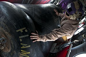 US Navy 120209-N-PB383-187 A Marine searches a fuel bag for leaks inside a CH-46E Sea Knight helicopter.jpg