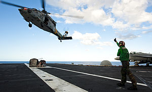US Navy 120212-N-OY799-114 A Sailor directs an MH-60S Sea Hawk helicopter from the Eightballers of Helicopter Sea Combat Squadron (HSC) 8 during a.jpg