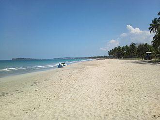 Trincomalee - Uppuveli Beach in Trincomalee city, a coastal resort city, with Konesar Malai in background